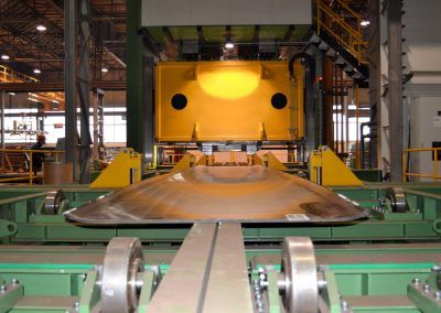 Pre-Bending Press for steel plates with 35000 kN pressing force with outfeed roller table