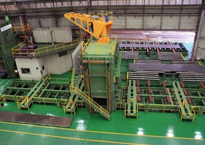 Pre-Bending Press for steel plates with 35000 kN pressing force with infeed and outfeed roller table